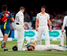ustralia's Steve Smith lays on the floor after being hit by a ball from England's Jofra Archer as...