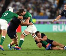 Ireland's Rory Best and Iain Henderson in action with Scotland's WP Nel and Allan Dell. Photo:...
