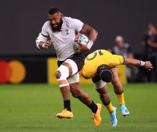 Fiji's Waisea Nayacalevu scores their second try. Photo: Reuters