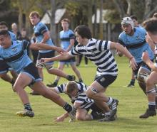 King's High School midfield back Giovanni Leituala goes for the tryline against Otago Boys' High...