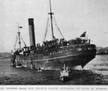 The troop transport Marama with her contingent of returned soldiers approaches the wharf at...