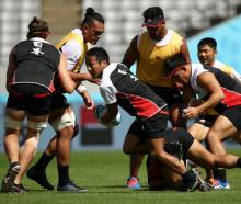 Yutaka Nagare clears the ball from a ruck at Japan training yesterday. Photo: Getty Images
