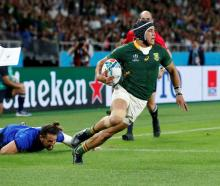 Cheslin Kolbe runs in to score a try for South Africa in their pool match against Italy. Photo:...
