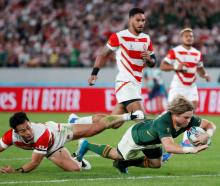 Faf de Klerk crosses the line in South Africa's win over Japan in the World Cup quarterfinals....