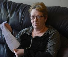 Dunedin bladder cancer patient Andrea Woodford holds a letter of apology sent to her by the...