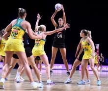 Ameliaranne Ekenasio lines up a pass during the Netball World Cup match between Australia and New...