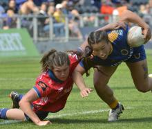 Tasman blindside flanker Tamara Silsock tries to drag down Otago second five-eighth Teilah...