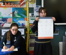 Writing down test results is Sophie Low (12) as Temple Chirnside (12) holds the vision chart....