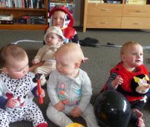 Enjoying some play fun at Radius Millstream are, back, Tama Pirika, 4, with brother Shane, five...