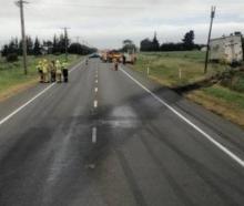 Emergency services at the scene near Rakaia on Sunday. Photo: Bridget Shimmin via NZ Herald