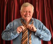 Former news reader Dougal Stevenson tries on the tie he wore for his last national news broadcast...