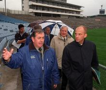 Otago rugby chief Colin Weatherall (left) shows Fifa events manager Michel Bachinni around...