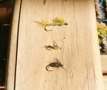 A damsel fly nymph (top), water boatman (middle) and snail imitations. Photo: Supplied