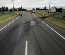Emergency services at the scene of a serious crash involving a truck and other vehicles near...