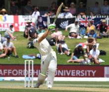 England's Jos Buttler hits a six. Photo: Reuters