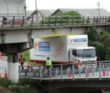 A Conroy Removals truck became stuck under the Humber St rail bridge in Oamaru yesterday after it...