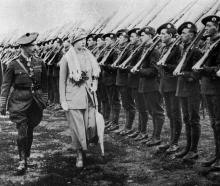Princess Mary, Colonel in Chief of the 1st Battalion of the Royal Scots Regiment, inspects troops...