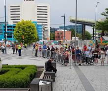 People prepare to meet Prince Charles and Duchess Camilla at Cathedral Square on Friday afternoon.