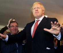 Boris Johnson speaks to supporters on a visit to meet newly elected Conservative party MP for...