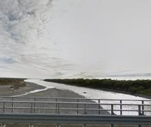 A view of the Arahura River, looking out to sea from the bridge on State Highway 6 north of...