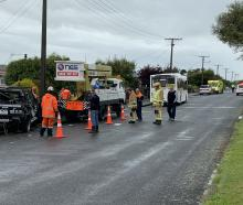 Emergency services at the scene of a crash in Invercargill after a bus hit a parked vehicle....