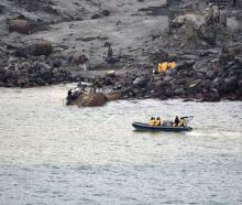 The  recovery operation under way at Whakaari/White Island yesterday. Photo by New Zealand...