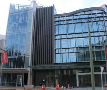 The defective structure on High St is the narrow, glass-fronted building to the left. Photo: RNZ...