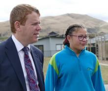 Minister of Education Chris Hipkins tours Shotover Primary School with pupil Iritana Matenga (12)...