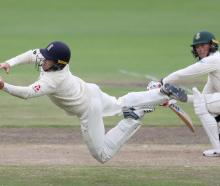 England's Ollie Pope takes a catch to dismiss South Africa's Rassie van der Dussen off the...