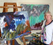 Jennifer Harrison with two of her recent weather-influenced abstract artworks.