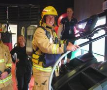 Checking out the stair climbers are Ashburton volunteer firefighters Warren Maslin (left) and...