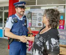 Constable Rick Groen, who is one of five police patrolling Hoon Hay more often, talking to Debbie...