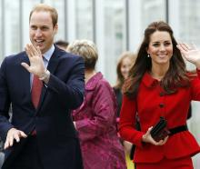 Prince William and Catherine, the Duchess of Cambridge, wave to the crowd at the Botanic Gardens....