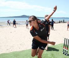White Fern Suzie Bates bowls during a game of beach cricket held as part of the ICC Women's...