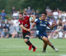 Braydon Ennor, of the Crusaders, wrong-foots Josh Ioane, of the Highlanders, during a Super Rugby...