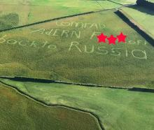 A pilot has captured a photo depicting a political statement mown into a Southland field. PHOTO:...