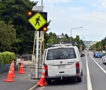 Downer staff complete testing of a smart crossing safety improvement system outside Kaikorai...
