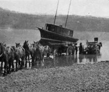 A motor launch conveyed from Dunedin to Hawea, being launched in the lake. — Otago Witness, 27.1...