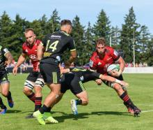Luke Romano of the Crusaders charges forward during the Super Rugby pre-season match between the...