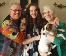 Steve Bush (left) with his daughter Grace, wife Janine and family doggo, Katniss (also known as...