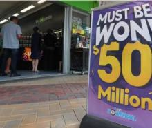 People queued up outside Lotto outlets around the country to get tickets for the record $50...
