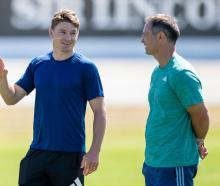 Beauden Barrett (left) talks with Blues coach Leon MacDonald. Photo: Getty Images