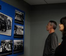 Jim and Julie Ryan, from Woodend, look at historic photos of Rangiora during their visit to the...