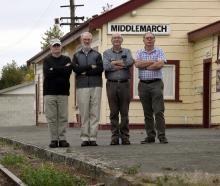 Otago Excursion Train Trust founding member Clark Simonds (left), trust life member Graeme Berry,...