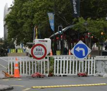 Picket fences, plants, and road cones mark the Octagon central carriageway's closure.