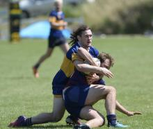 Taieri's Marc Rooney wraps up West Taieri's Jacob Wells at the Spartans 10s tournament at Miller...