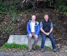 Fulton Hogan senior bid manager Joe Connolly (left) and Otago Peninsula Community Board chairman ...