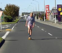 A skateboarder enjoys a clear run in Andersons Bay Rd at lunchtime yesterday. PHOTO: STEPHEN...