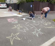 The McKinnel family, of Edgeware, get creative in their driveway. Photo: Geoff Sloan