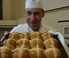 Chef Daniel Pfyl shows off a tray of freshly baked hot cross buns. Photo: Linda Robertson